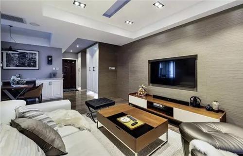 客厅电视背景墙采用kd板,电视机内嵌,电视线,插座等隐藏起来,呈现出一图片