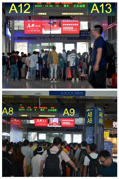 居典红木在客流众多的广州南站检票口处的LED屏广告